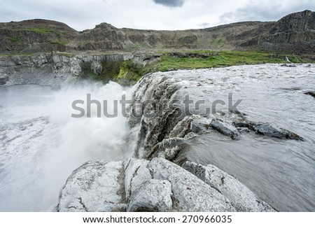 Hafragilsfoss is the very powerful waterfall on Iceland not far from its bigger brother Dettifoss. It is located in Jokulsargljufur National Park the northeasten Iceland on the river Jokulsa Fjollum. - stock photo