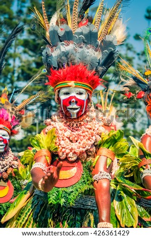 Hagen show, Papua New Guinea - circa August 2015: Native woman with red and white colour on face during Hagen show, Papua New Guinea. Documentary editorial.