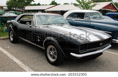 HAGERSTOWN, MD - JUNE 29, 2014: Image of a Chevrolet Camaro, proceeds from the car show benefit the newspapers in education program.  - stock photo