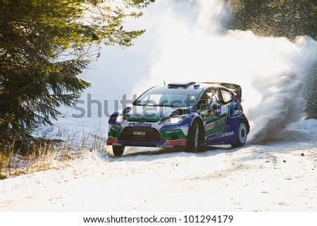 HAGFORS, SWEDEN - FEB 09: Jarri-Matti Latvala in his Ford Fiesta WRC during the Shakedown stage in  Rally Sweden 2012 in Hagfors , Sweden on Feb 9, 2012 - stock photo