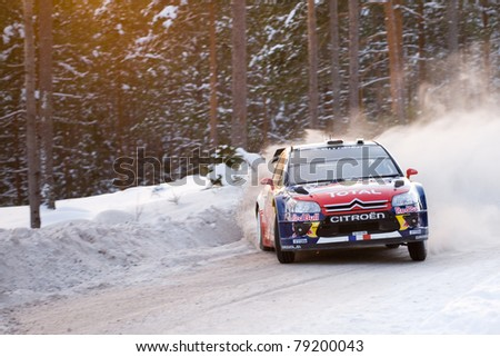HAGFORS, SWEDEN - FEB 13: Sebastien Loeb drifting with his Citroen WRC car during the event Rally Sweden 2010, in Hagfors, Sweden on February 13, 2010 - stock photo