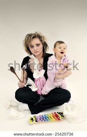 Haggard mother and happy child - stock photo