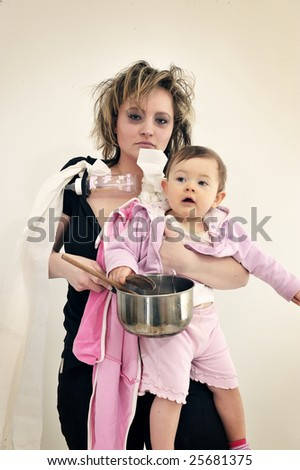 Haggard mother with her adorable baby - stock photo