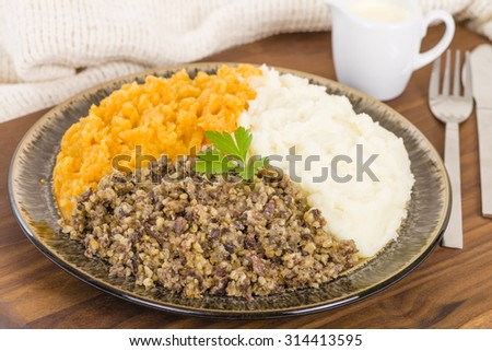 Haggis, Neeps & Tatties - Traditional Scottish meal commonly served at Burn's Night. Served with whisky sauce. - stock photo