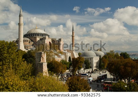 Hagia Sofia in Istanbul -  view from top, with trees and clouds. Hagia Sofia is one of most famous mosque, also marked as one of Asian 7th wonders located in Istanbul, Turkey - stock photo