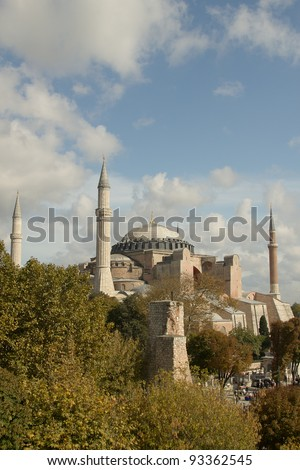 Hagia Sofia in Istanbul -  view from top, with trees and clouds - vertical. One of most famous mosque, also marked as one of Asian 7th wonders located in Istanbul, Turkey - stock photo