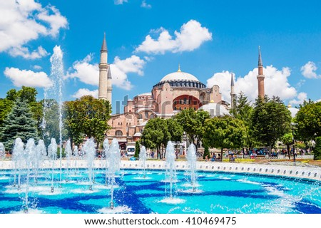 Hagia Sophia (Ayasofya) museum and fountain view from the Sultan Ahmet Park in Istanbul, Turkey - stock photo