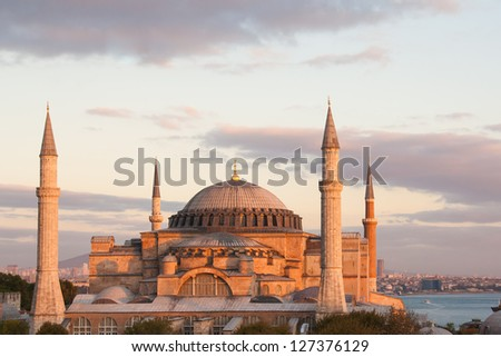 Hagia Sophia caught in the dying rays of the sun, straight on view. - stock photo