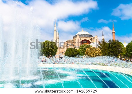 Hagia Sophia, former Orthodox patriarchal basilica (church), later a mosque, and now a museum as seen from Sultanahmet Park on a sunny day.; Istanbul, Turkey. - stock photo