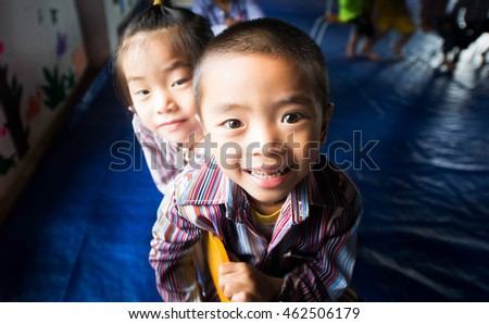 "HAGIANG, VIETNAM - SEPTEMBER 17 : ""Hmong"" children enjoy in school at Hagiang, the north province of Vietnam in Sep. 17, 2015. ""Hmong"" is hill tribes that live on the high mountain."