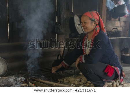 HAGIANG, VIETNAM - SEPTEMBER 17,2015 : Unidentified Hmong woman hill tribes of Vietnam cooking meal in her house in Hagiang, Vietnam.