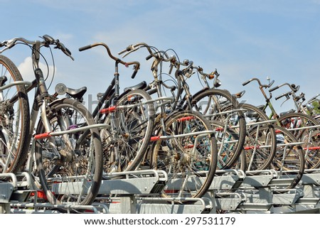 HAGUE, NETHERLANDS-AUGUST 01, 2014: Bicycles parked on street in modern center of Hague