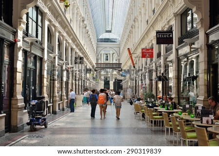 HAGUE, NETHERLANDS-AUGUST 01, 2014: Tourists crowded gallery with shops in the center of Hague. - stock photo