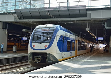 HAGUE, NETHERLANDS-AUGUST 01, 2014: Train waiting for passengers in The Hague Central railway station or Den Haag Centraal - stock photo