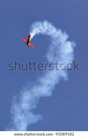 HAHNWEIDE AIRBASE, GERMANY - SEPTEMBER 04: Flying display and aerobatic show of Leki-Extra 330 SC in Hahnweide International Airshow , Germany on 04 September, 2011 - stock photo