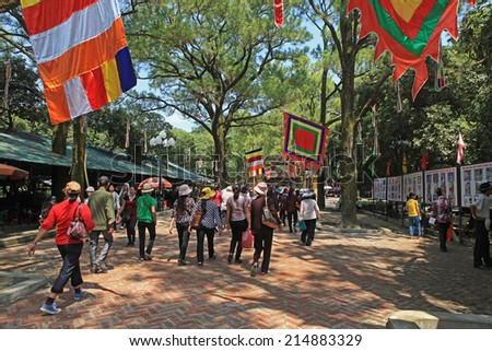 HAI DUONG, VIETNAM - AUG 31, 2014: Asian people visiting Con Son ancient temple in Chi Linh district, Hai Duong province. The temple is one of the most well known religious point in Vietnam. - stock photo