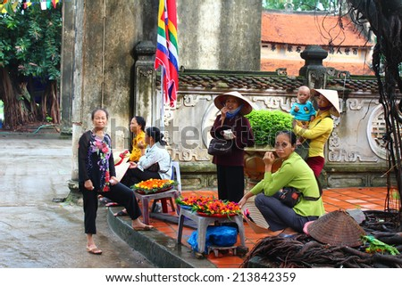 HAI DUONG, VIETNAM, AUGUST, 29: group of people selling goods in market on August, 29, 2014 in Hai Duong, Vietnam. - stock photo