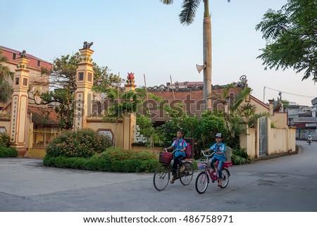 HAI DUONG, Vietnam, September 17, 2016 students, rural Hai Duong, biking to school