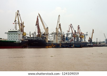 HAI PHONG, VIETNAM - AUGUST 4: Cargo ships in a port on August 4, 2012 in Hai Phong, Vietnam. Hai Phong port is one of the two biggest ports in Vietnam.
