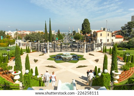 Haifa, Israel - Oct 27, 2014: Tourists at The Baha'i gardens and temple, on the slopes of the Carmel Mountain, in Haifa Israel. Also known as the Hanging Gardens of Haifa, a UNESCO World Heritage Site