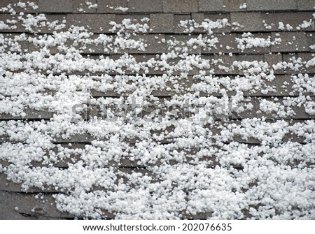Hail on the Roof. After Heavy Storm with Hail. Roof Closeup. - stock photo