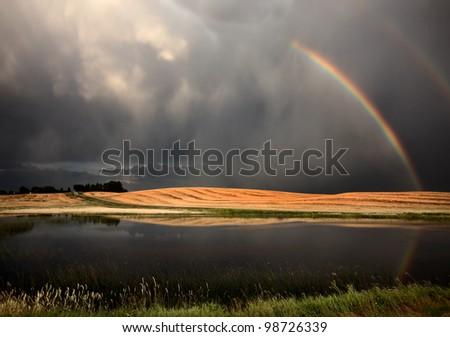 Hail Storm and Rainbow in Saskatchewan Canada - stock photo