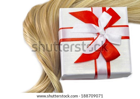 Hair and present - stock photo