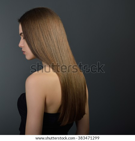 Hair. Beautiful brown-haired girl. Healthy long hair. Beauty. Beautiful woman. Hairstyle. Skincare. Female face. - stock photo