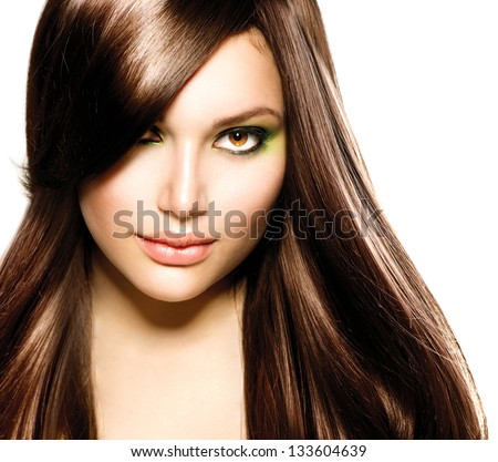 Hair. Beautiful Brunette Girl. Healthy Long Brown Hair. Beauty Model Woman. Hairstyle. Stylish Haircut. Fringe. Glossy Smooth Fashion Hair. Extensions - stock photo