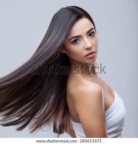 Hair. Beautiful Brunette Girl. Healthy Long Hair. Beauty Model Woman. Hairstyle. Hair care - stock photo