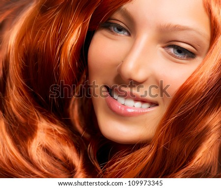 Hair. Beautiful Girl With Healthy Long Red Curly Hair. Extension - stock photo