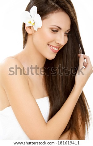 Hair. Beautifull Woman with Long Healthy and Shiny Smooth Brown Hair. Brunette Girl isolated on a white background. - stock photo
