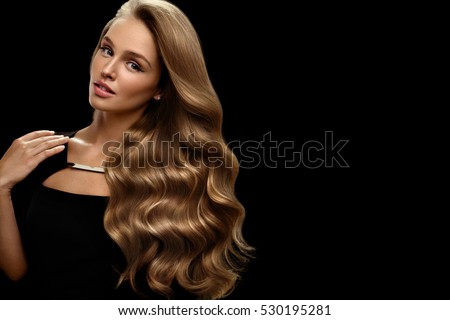 Hair Beauty And Makeup. Beautiful Fashion Girl Model With Perfect Blonde Hair Color And Gorgeous Face. Attractive Sexy Woman With Healthy Long Shiny Wavy Curly Hair Posing In Studio. High Resolution