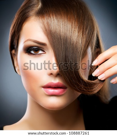Hair. Beauty Girl With Healthy Long Brown Hair - stock photo
