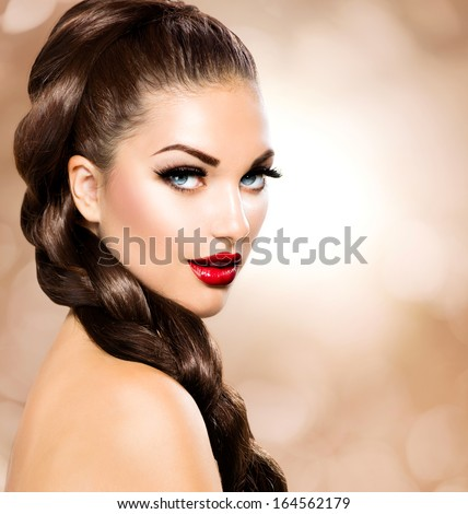 Hair Braid. Beautiful Woman with Healthy Long Brown Hair. Hairdressing. Hairstyle. Beauty Glamour Fashion Model Girl Portrait. Perfect Skin and Makeup Holiday Make up. Blue eyes and Red Lipstick - stock photo