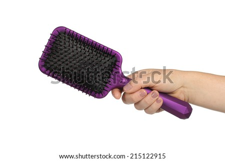 Hair brush in hand on a white background - stock photo