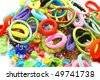 Hair clips and elastic rings isolated on white background. - stock photo