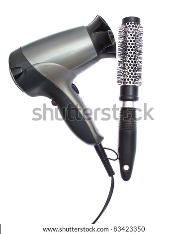 Hair dryer and brush isolated on white - stock photo