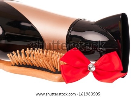 Hair dryer with hair accessories over white background close-up - stock photo