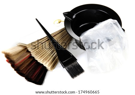 Hair dye kit and hair samples of different colors, isolated on white - stock photo