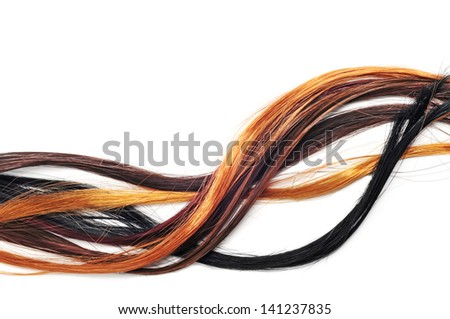 hair extensions of different colors on a white background - stock photo