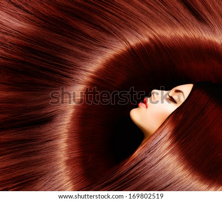Hair. Healthy Long Brown Hair. Beauty Brunette Woman with Smooth Gorgeous Red Hair. Beautiful Model Woman Portrait - stock photo