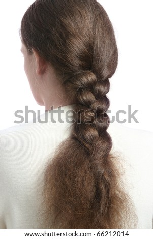 Hair in braid. Woman back with braided hair. Brown hairs tressed in long plait. - stock photo