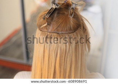 Hair extensions stock images royalty free images vectors hair is sewn on a pigtail hair extensions blond blonde white pmusecretfo Image collections