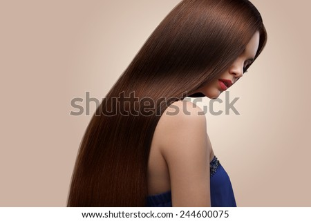 Hair. Portrait of Beautiful Woman with Long Brown Hair. High quality image. - stock photo