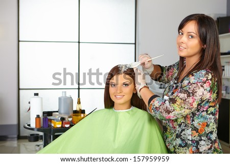 Hair salon. Coloring of roots. - stock photo