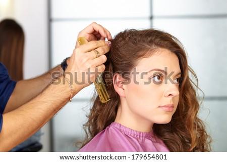 Hair salon. Woman haircut. Combing. - stock photo