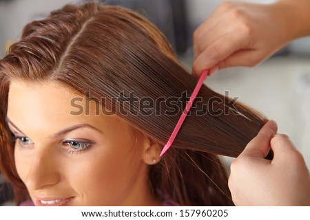Hair salon. Women`s haircut. Combing. - stock photo
