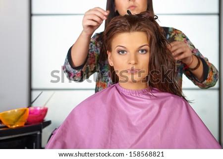 Hair salon. Women`s haircut. Combing. - stock photo