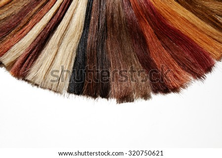 hair samples, extensions separated on white - stock photo